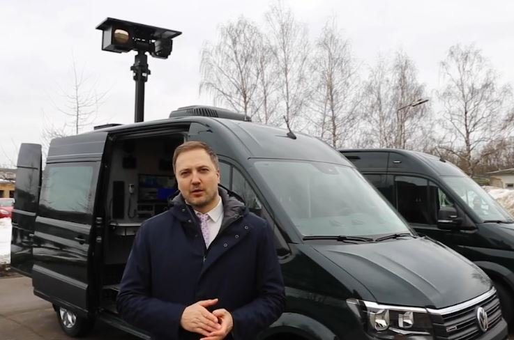 Interior minister with surveillance van